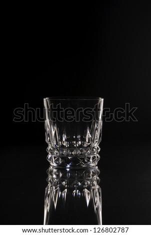 Rocks Glass Tumbler Cocktail Glass Clear, Dark Field Lighting, Studio setup Black and White - stock photo