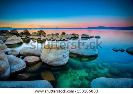 Rocks in a lake, Lake Tahoe, Sierra Nevada, California, USA - stock photo