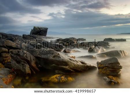 Rocks in Loch Scavaig near Elgol, Isle of Skye, Scotland - stock photo