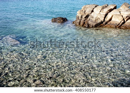Rocks in the transparent sea in Mykonos,Greece - stock photo