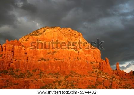 Rocks near chapel of holy cross as sun drops - stock photo
