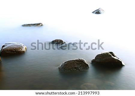 rocks sea shore - stock photo