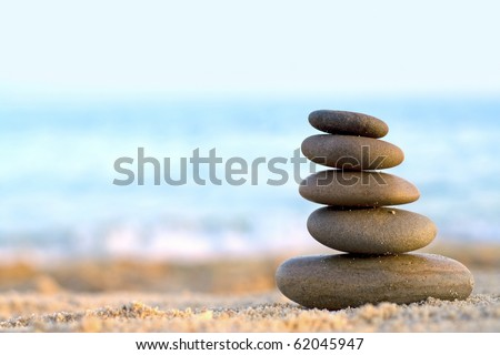 Rocks Stacked one on top of another on the background of the sea - stock photo