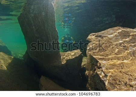 Rocks under the water surface - stock photo
