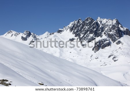 Rocky and snowy peaks in Alps mountains - stock photo