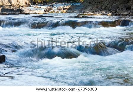 Rocky Autumn Mountain River and waterfalls - stock photo