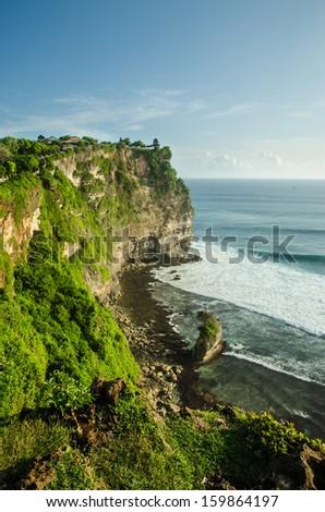 Rocky beach near Ulawatu temple on Bali, Indonesia - stock photo