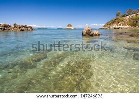 Rocky beach of Nosy Be island, Madagascar - stock photo