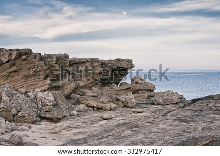 Rocky Cliffs at Mediterranean sea coast. Vintade filter effect - stock photo