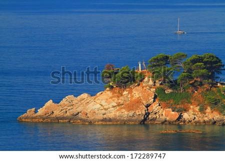 Rocky cliffs on the Adriatic sea shore - stock photo
