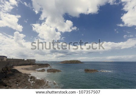 Rocky coast and town wall in Saint-Malo - Saint-Malo, Brittany, France - stock photo