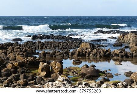 Rocky coast at Ireland ( Giants Causeway)  - stock photo