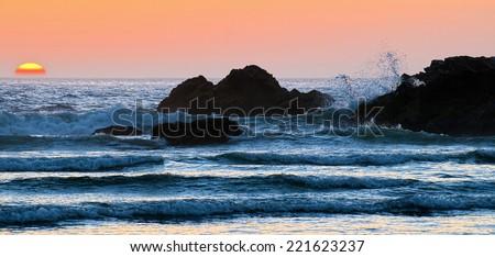 Rocky Coast Beach and Sunset, Cannon Beach Oregon USA - stock photo