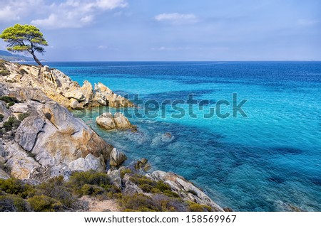 Rocky coast in Chalkidiki, Sithonia, Greece, with crystal clear water - stock photo