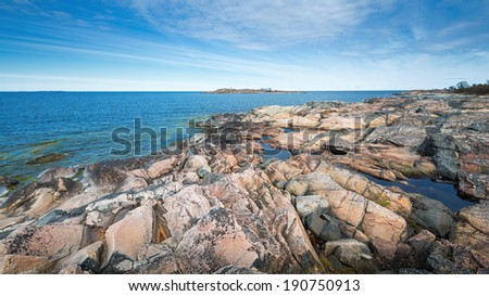 Rocky coast with different types and color of rock in Grisslehamn, Sweden - stock photo