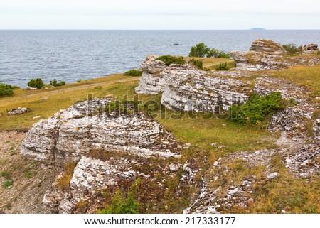 Rocky coast with limestone sea stack on the beach - stock photo