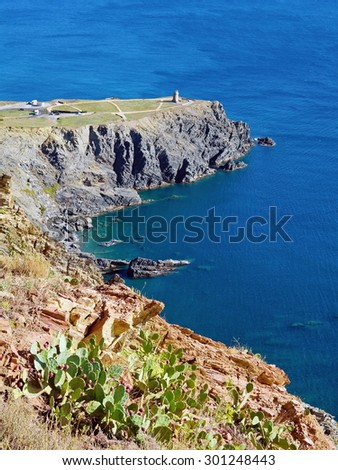 Rocky coast with the Cap Cerbere at the border between Spain and France, Mediterranean sea - stock photo