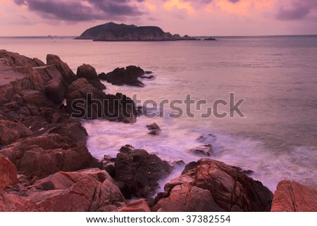 Rocky coastline before sunrise in the southeast of China - stock photo
