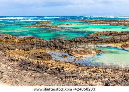 Rocky Coastline With Turquoise Lagoons - El Cotillo, Fuerteventura, Canary Islands, Spain - stock photo