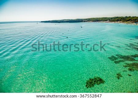 rocky cove on the coast of Salento in Puglia in Italy - stock photo