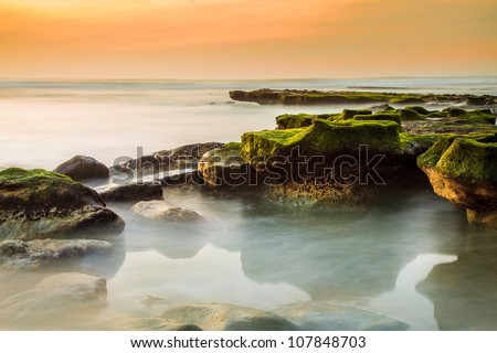 Rocky Del Mar Coastline - A long exposure of the rocky, exposed beach after a series of winter rainstorms washed away much of the sand. - stock photo