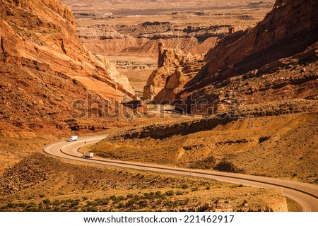 Rocky Desert Utah Highway with Semi Trucks. Scenic Utah Interstate Highway I-70. United States. - stock photo