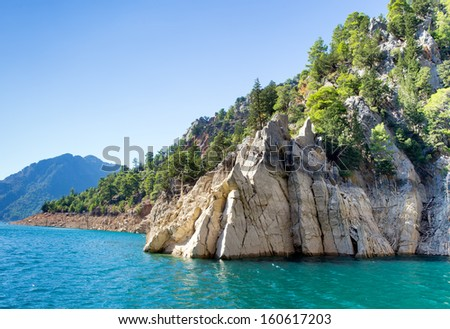 Rocky island green canyon in a mountain lake, Manavgat  Turkey  - stock photo