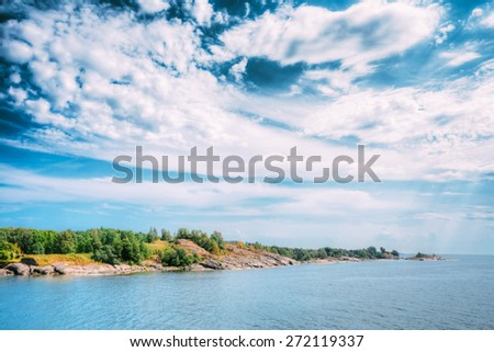 Rocky Island Near Helsinki, Finland. Summer Sunny Day. Seashore Landscape, Nature Of Finland. - stock photo
