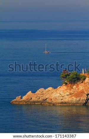 Rocky island on the Adriatic sea - stock photo