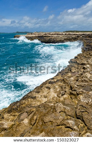 Rocky Limestone Coastline Devil's Bridge Antigua - stock photo