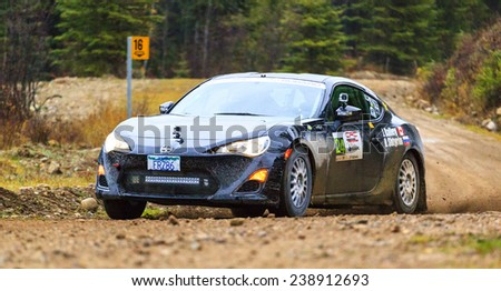 ROCKY MOUNTAIN 1/11/2014 CANADA Some of the best drivers  from Canada and the USA are competing in the Rocky Mountain. The race held in different province of Canada's best dirt roads for motor sport.  - stock photo