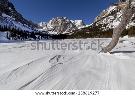 Rocky Mountain National Park - frozen Loch Vale on a cold, sunny winter morning. - stock photo