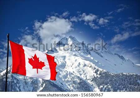 Rocky Mountain range and Canada flag - stock photo