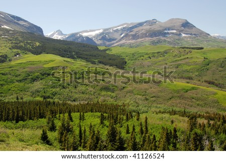 Rocky mountain ridge and meadows in glacier national park, montana, usa - stock photo