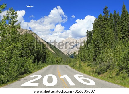 Rocky Mountains highway with numbers 2016 (New year of Two thousand sixteen ) are written on the road going to prospect - stock photo