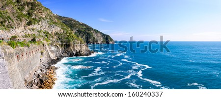 Rocky mountains on the coastline, Via del Amore in the national park Cinque Terre, Italy - stock photo