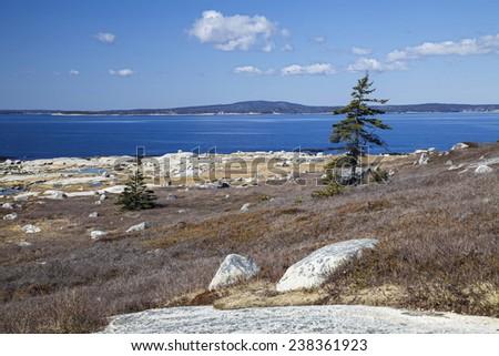 Rocky Nova Scotia shoreline near Peggy's Cove. - stock photo