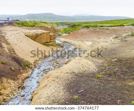 rocky scenery including a hot spring seen in Iceland - stock photo