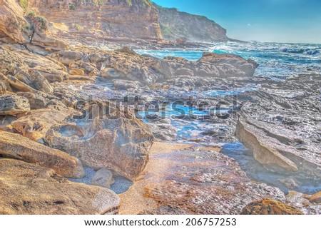 rocky shore in Castelsardo, hdr - stock photo