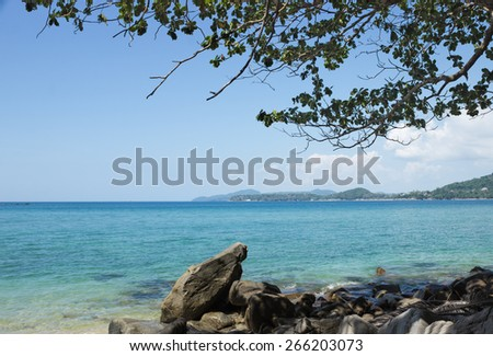 Rocky shore of the Andaman sea, Phuket, Thailand - stock photo