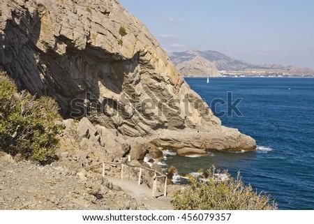 Rocky shore of the black sea coast.Golitsin's path.Crimea. - stock photo