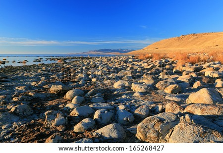 Rocky shore on Antelope Island, Great Salt Lake, Utah, USA. - stock photo
