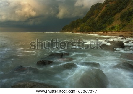 Rocky shores of the Baltic Sea with a long exposure in anticipation of the impending storm - stock photo
