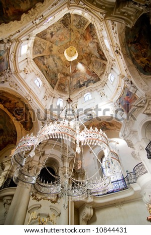 Rococo church ceiling, chandelier and fresco - stock photo