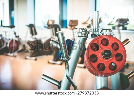 Rod and weights in the gym - stock photo