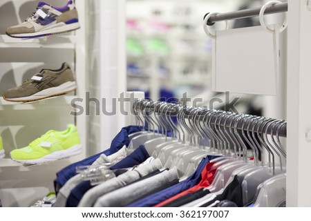 rod with hangers and empty price board in the sporting goods store - stock photo