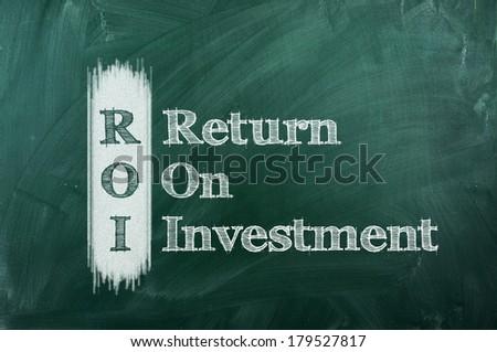 ROI acronym on green chalkboard, Return On Investment - stock photo