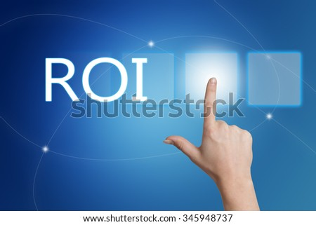ROI - Return on Investment - hand pressing button on interface with blue background. - stock photo