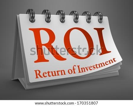 ROI - Return on Investment - Red Text on White Desktop Calendar. - stock photo
