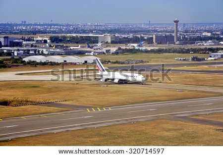 ROISSY, FRANCE -10 AUGUST 2015- An Airbus A380 double-decker airplane from Air France (AF) gets ready for take-off at the Roissy Charles de Gaulle International Airport (CDG) near Paris, France. - stock photo